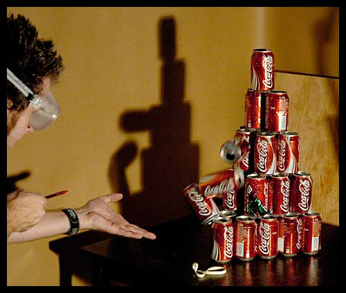 Picture of Espen shooting a coke can tower with the Rubber TEC