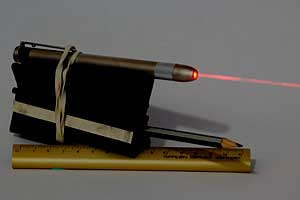 The Super Maul with a laser pen mounted and laser turned on. The red laser beam is visible.