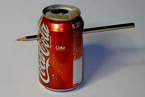 An empty coke can with a pencil shot through it.
